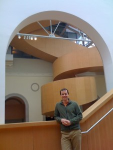 Andrew in front of Staircase