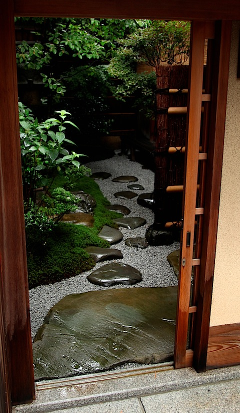 Japanese garden framed in door