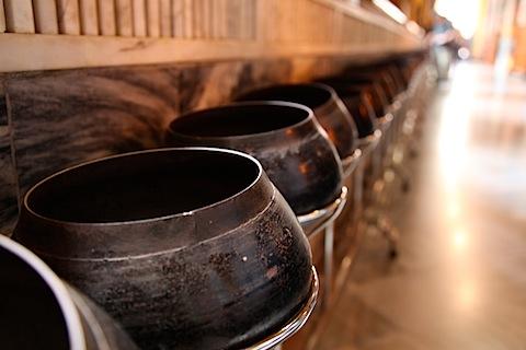 Offering bowls at Reclining Buddha