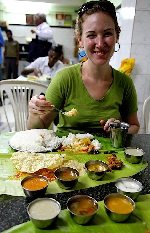 Wendy eating off banana leaf at Manorama