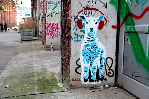 Street art sheep with headphones